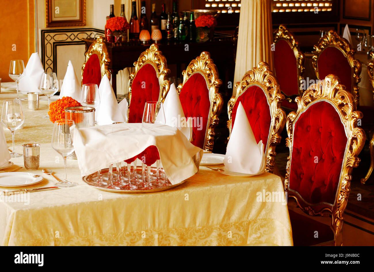Single row of chairs of Dinning table in 1135 AD restaurant inside Amber fort, Jaipur, Rajasthan, India interior - Stock Image