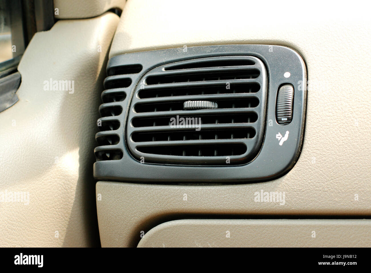 Ordinary car Air Conditioner in light colored interior - Stock Image