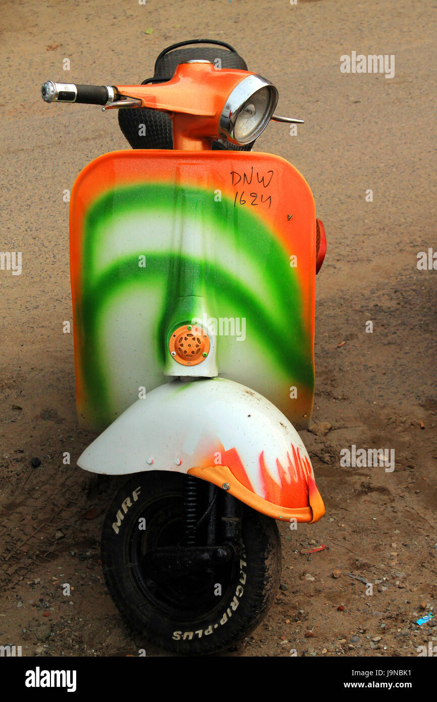 A scooter painted in Indian national flag tricolor pattern showing patriotism - Stock Image