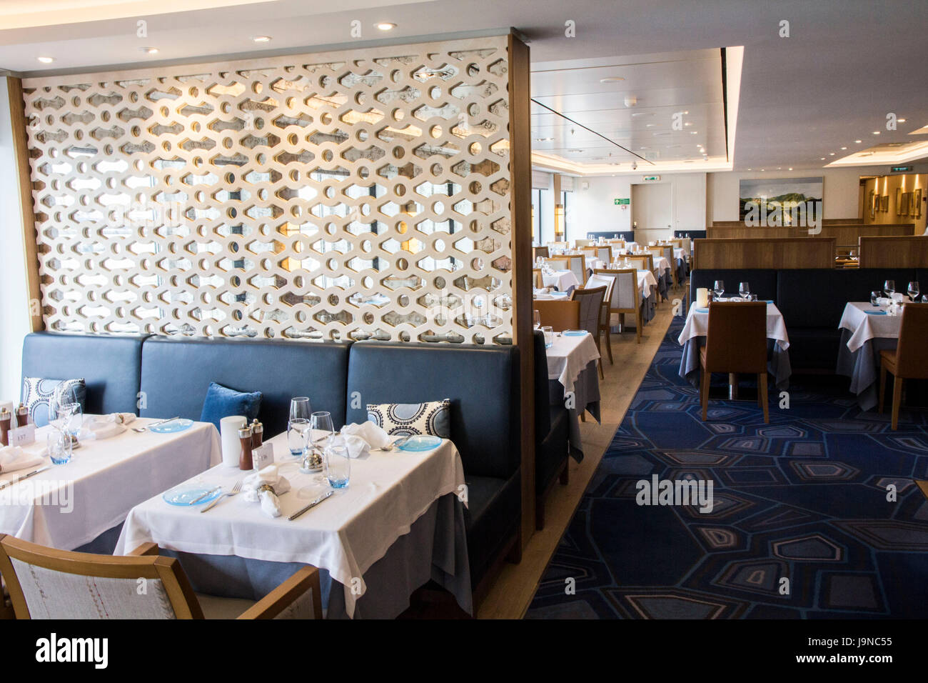 The Restaurant is Viking Sea's airy and coimfortable main dining room, featuring a daily-changing menu highlighting - Stock Image