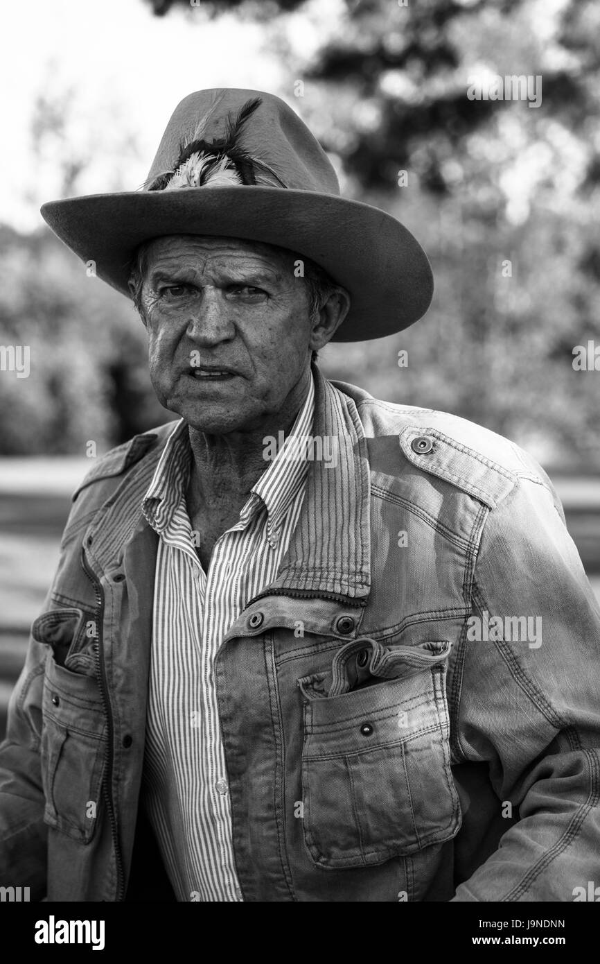 5024669351edf Black and white portrait of a retired elderly man in a cowboy hat with a  serious