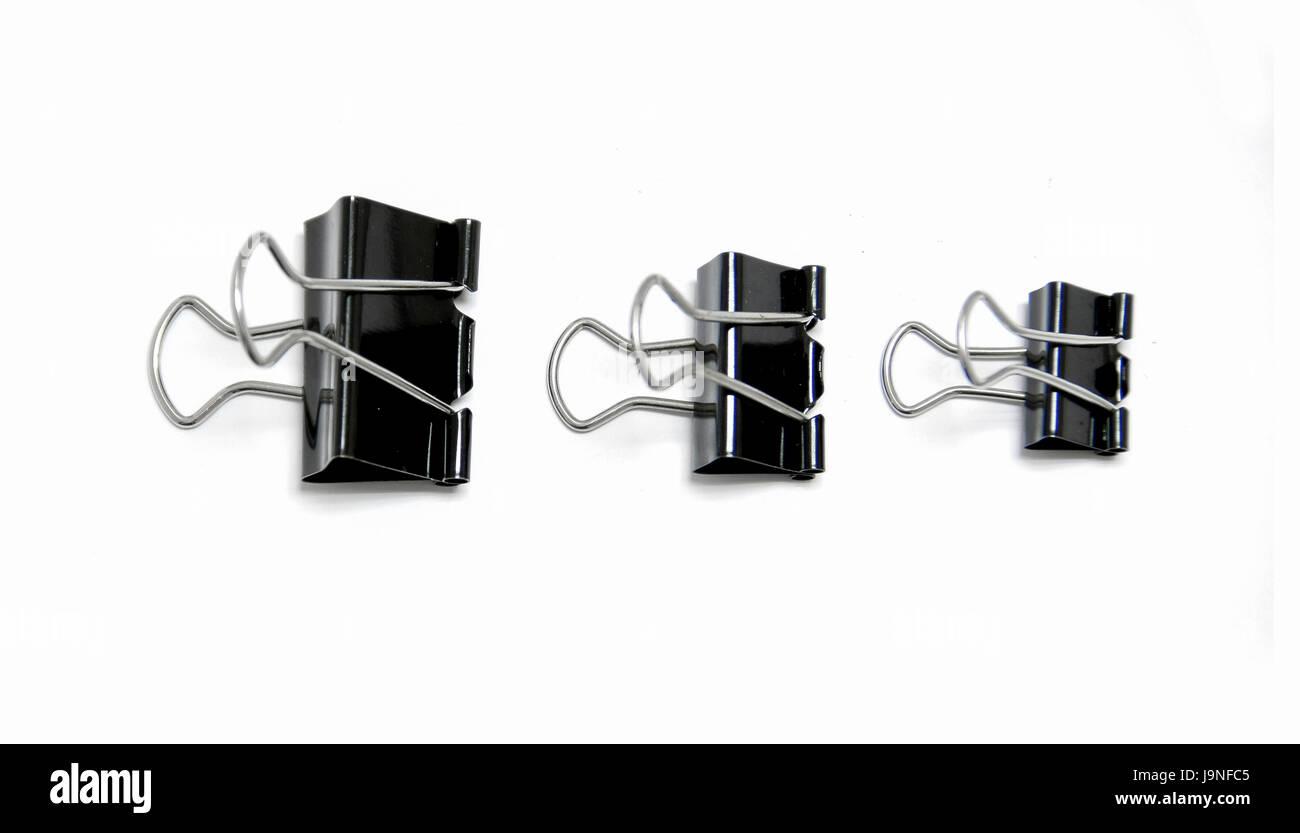 three size black clips on white background - Stock Image