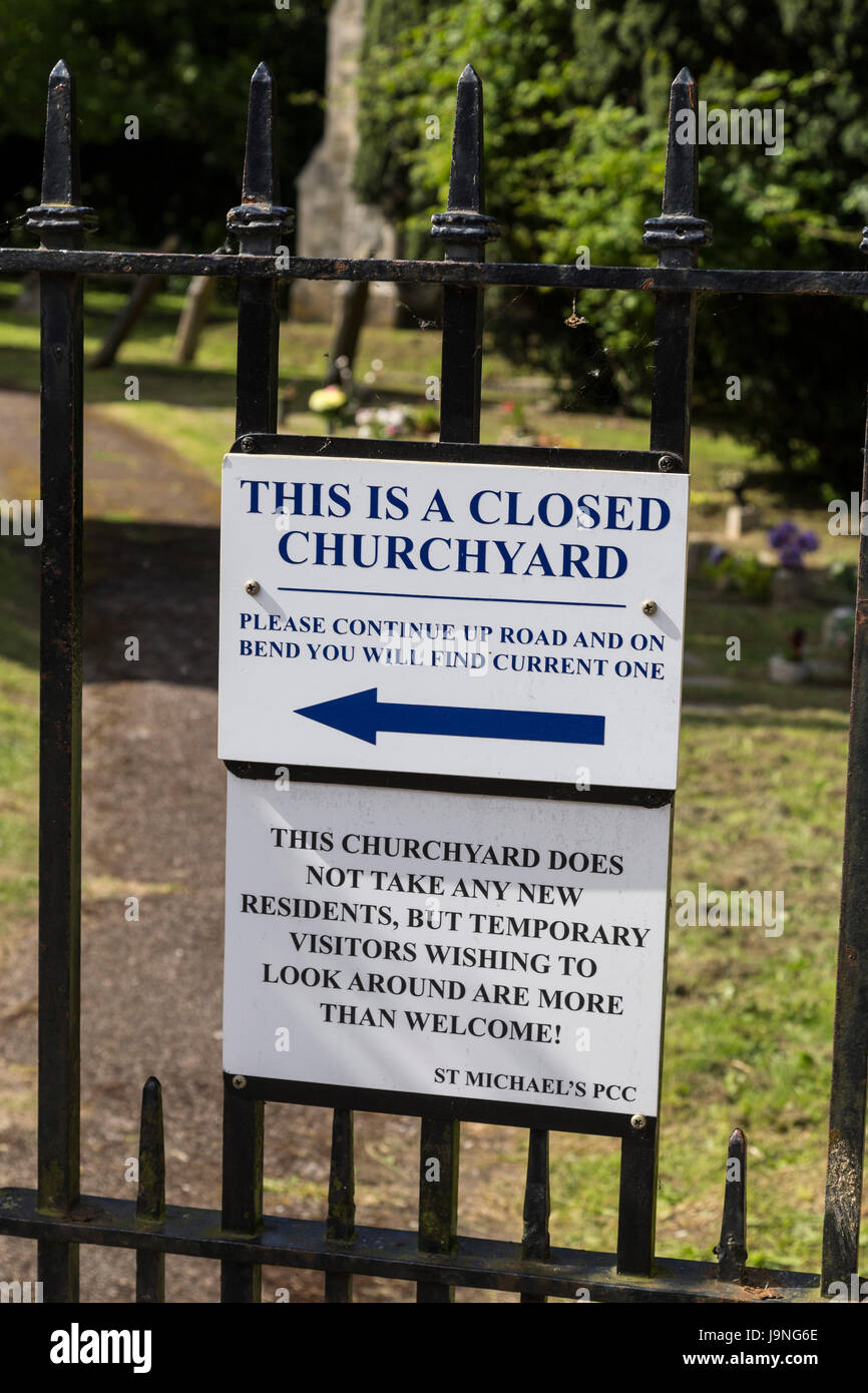 Amusing graveyard sign in Beer, Devon. Funny cemetery notice. - Stock Image