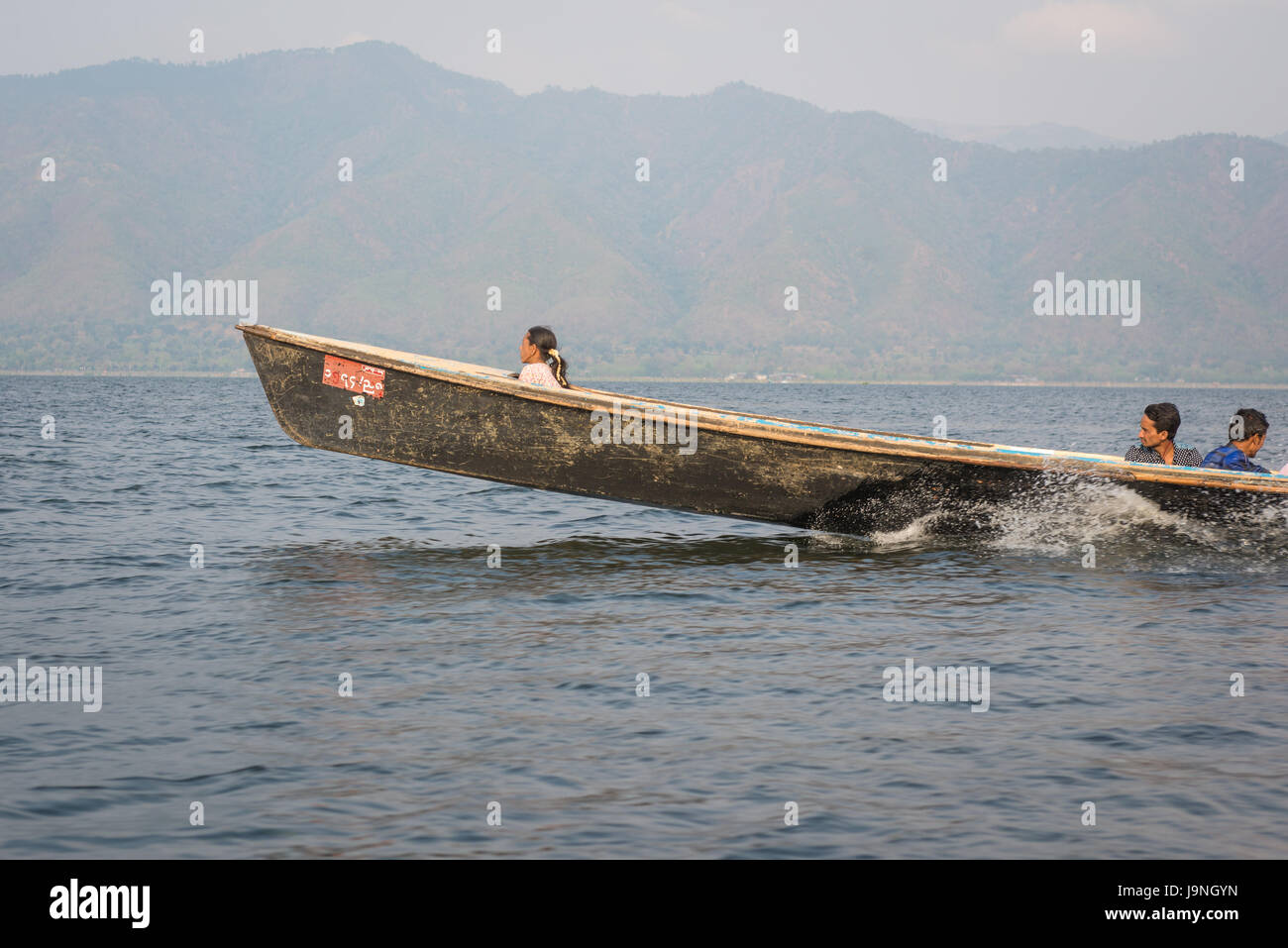 Travelling in a motorboat on Inle Lake, Myanmar. - Stock Image