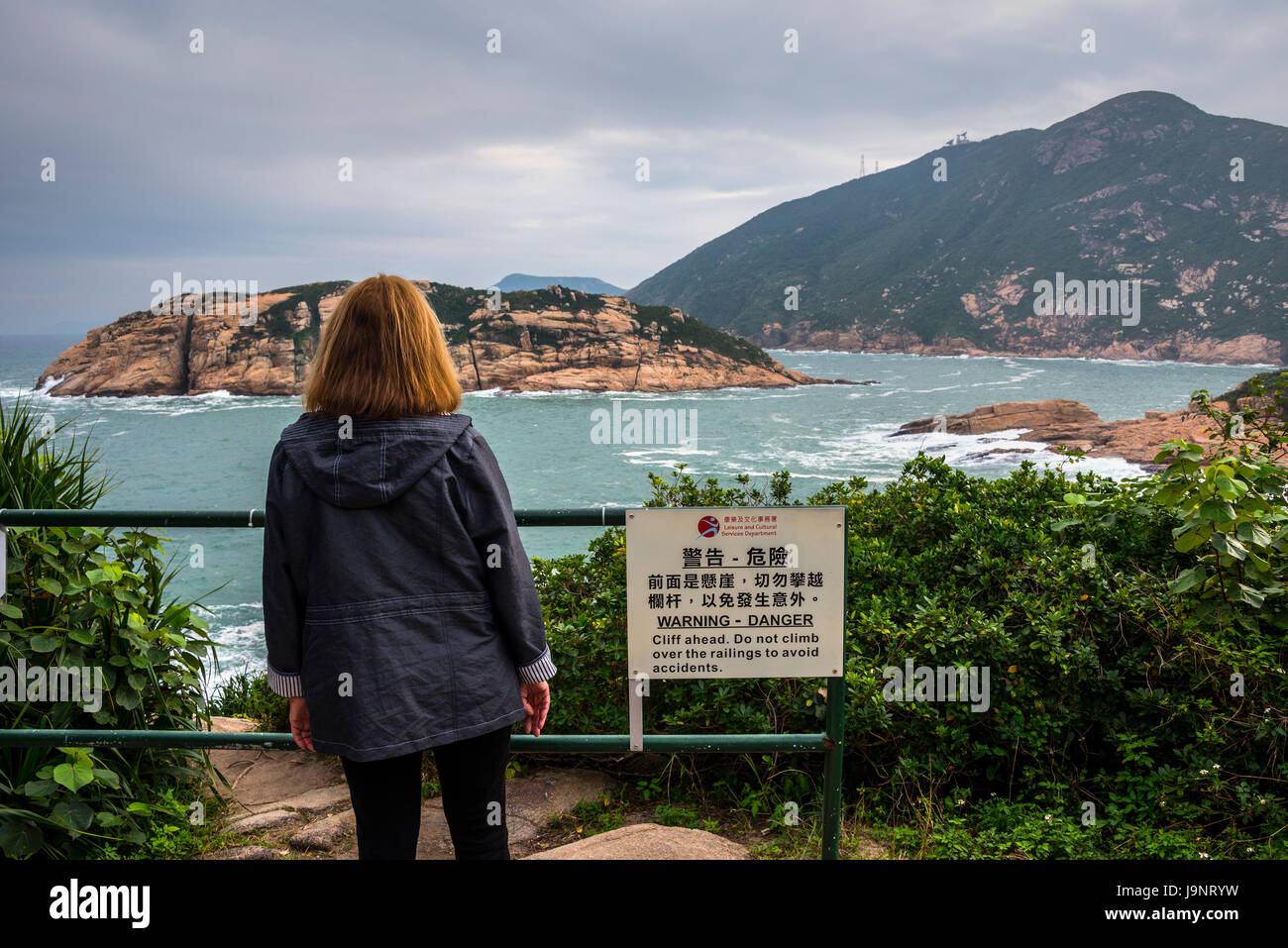 Shek-O Coastline, Hong Kong, with Cliff Warning Sign - Stock Image