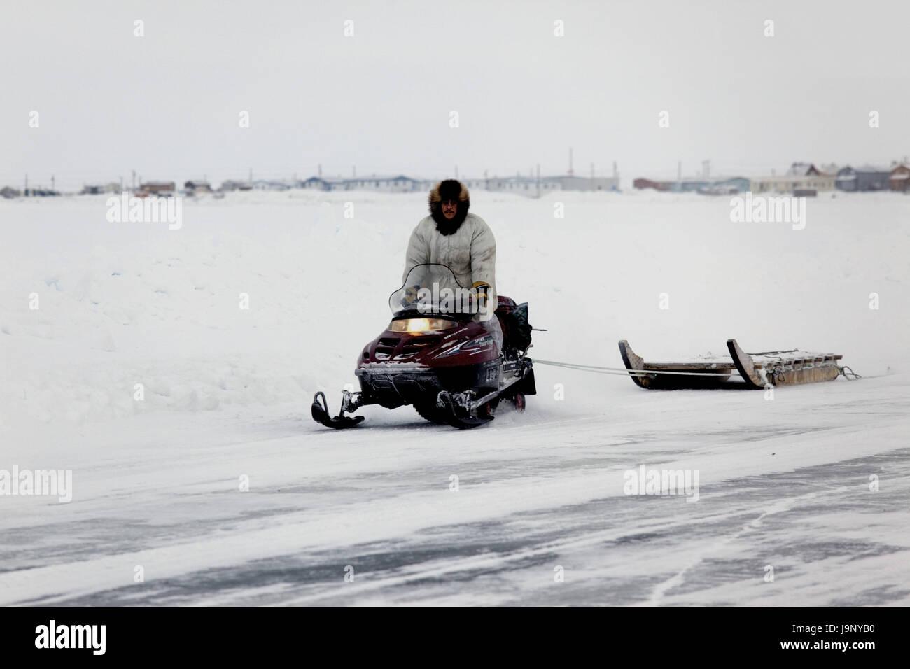 North America,Canada,north west territory,Northwest Territory,Iceroad,Tuktoyaktuk,Ice-Road,Tuktoyaktuk,Inuit,snowmobile, - Stock Image