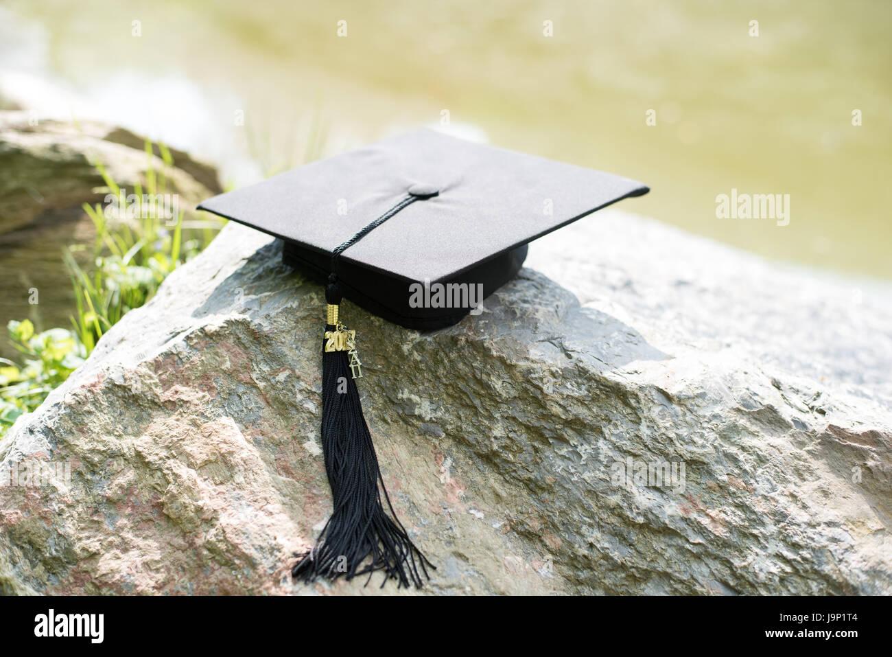 Graduation Cap on Rock - Stock Image