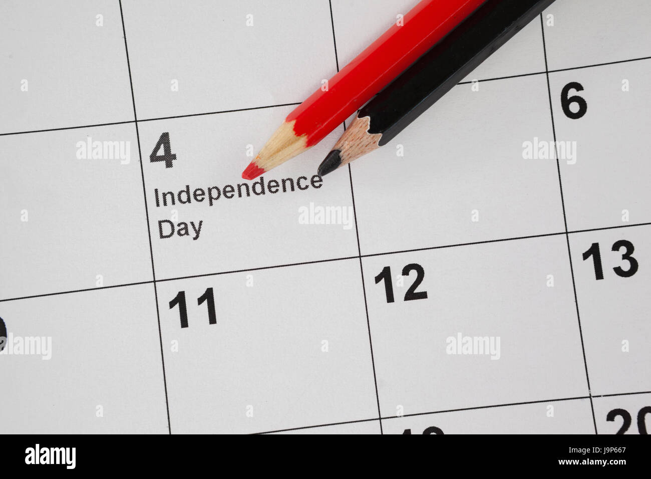 Close-up of colored pencil with fourth of july calendar - Stock Image