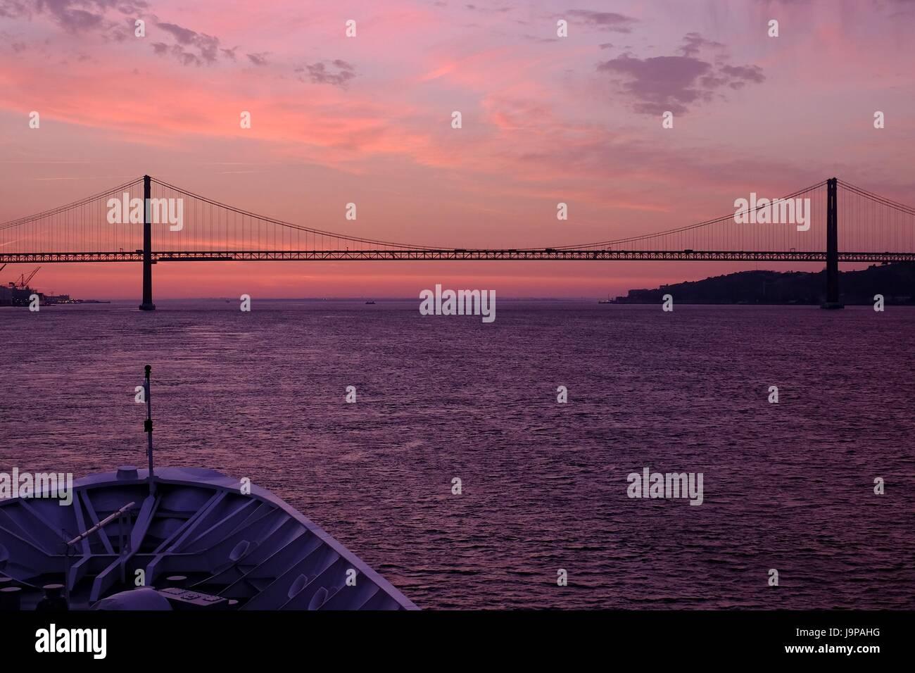 Lisbon - 25 de Abril Bridge and The Sanctuary of Christ the King Monument Stock Photo