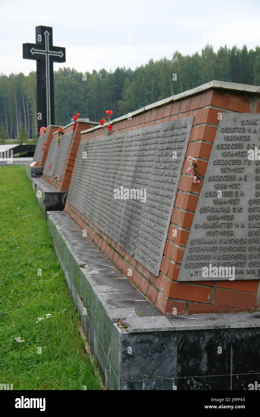 Russia,Yekaterinburg,the west,monument for the offerings of the dimension murder in 1937-38,Stalin's regimen,inscription,name,flowers,cross, - Stock Image