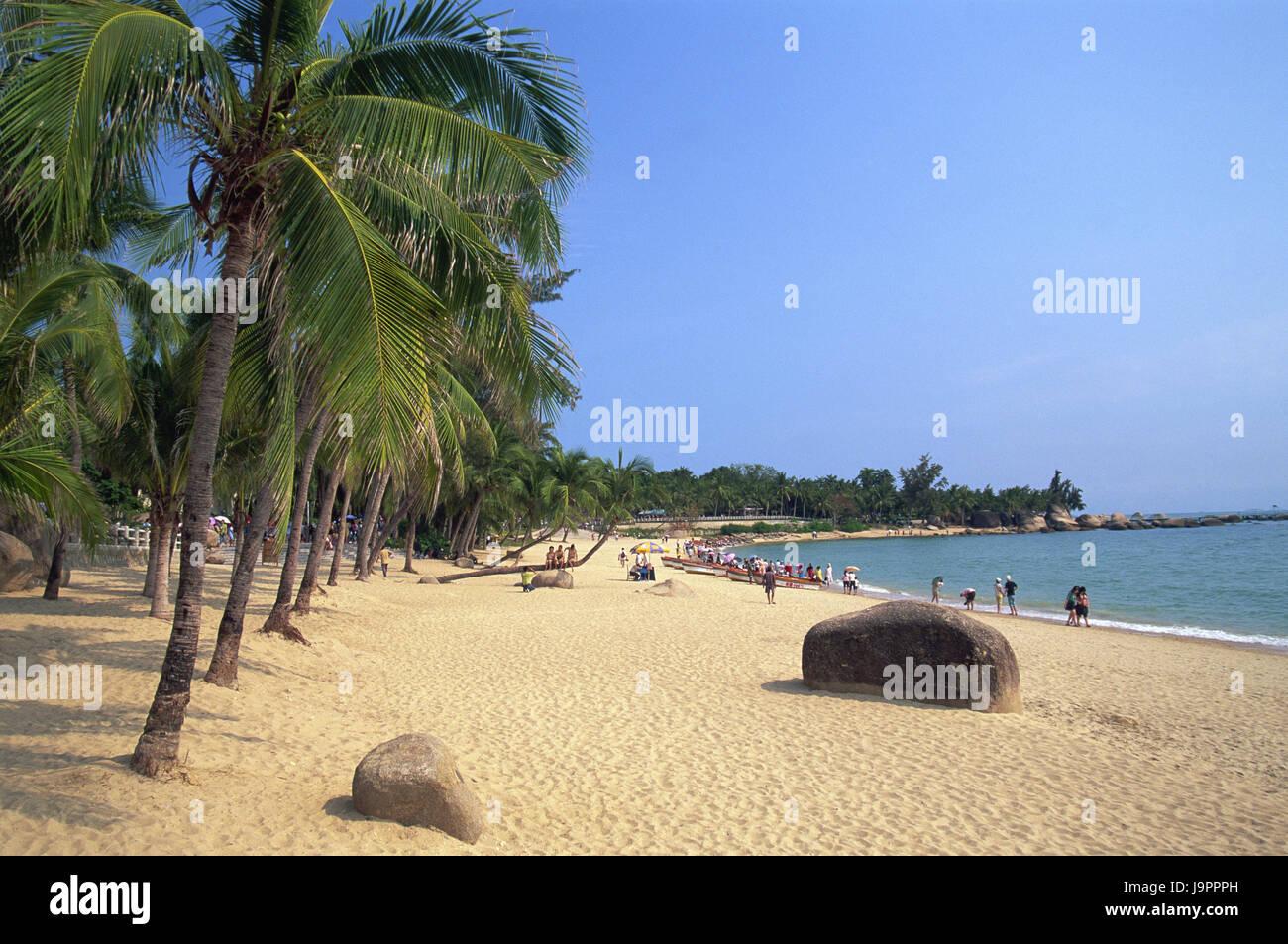 China,Hainan Iceland,Sanya,sandy beach,rock,palms,tourists,Asia,Eastern Asia,destination,beach,vacation,tourism,beach - Stock Image