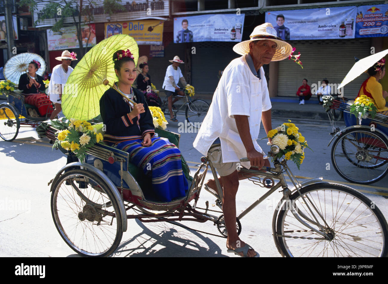 Thailand,Chiang May,flower festival,save,bicycle rickshas,floral decoration,women,display screen,sit,no model release,Asia,Nordthailand,feast,festival,holiday,person,locals,Asian,men,drivers,rickshas,transport,personal - Stock Image