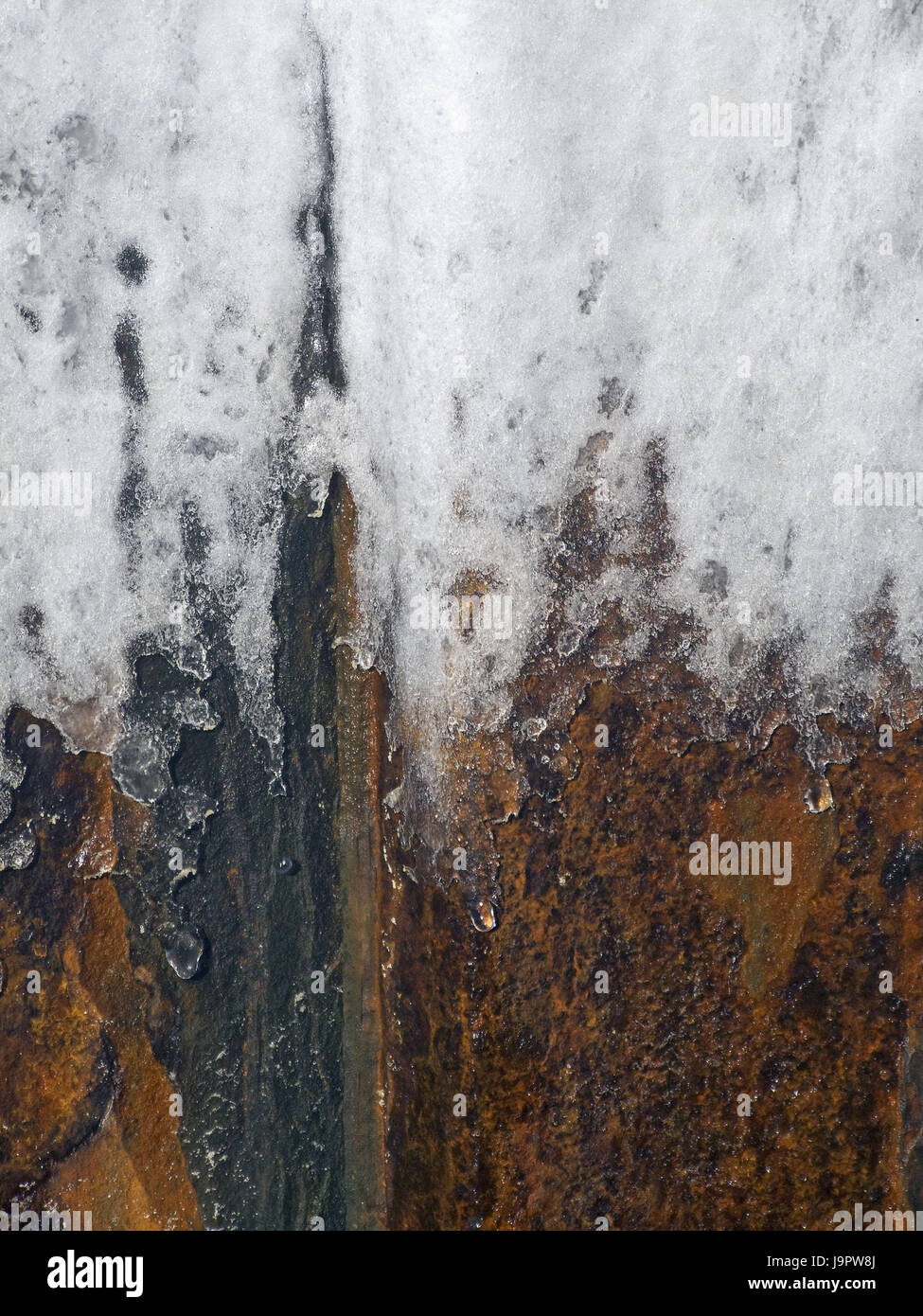Metal plate,old,rusty,E sharp,close up,metal,iron,steel,corrosion,remains,iron,rust,freezes over,layer of ice,cold,coldly,season,thaw,winter,expiration,transitoriness,nobody,medium - Stock Image