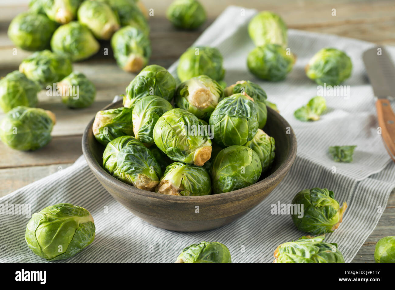 Raw Organic Green Brussel Sprouts Ready to Cook With - Stock Image