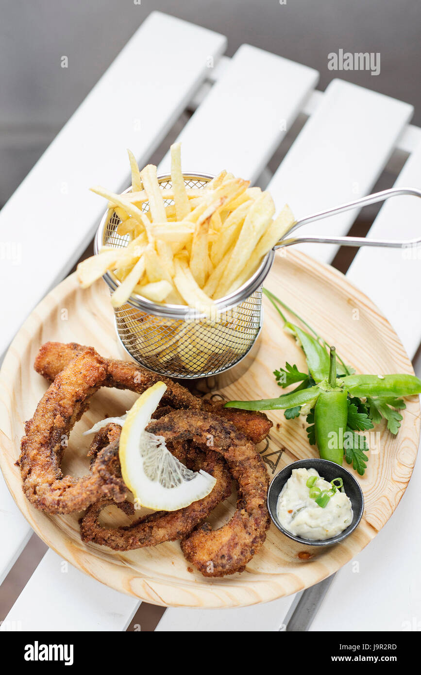 fried octpus seafood rings calamari style with fries tapas snack set - Stock Image