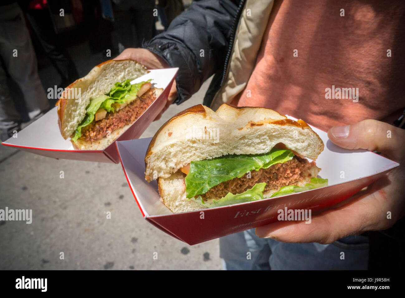 A diner with her orders of plant-based 'hamburger' in New York on Wednesday, May 31, 2017. (© Richard - Stock Image