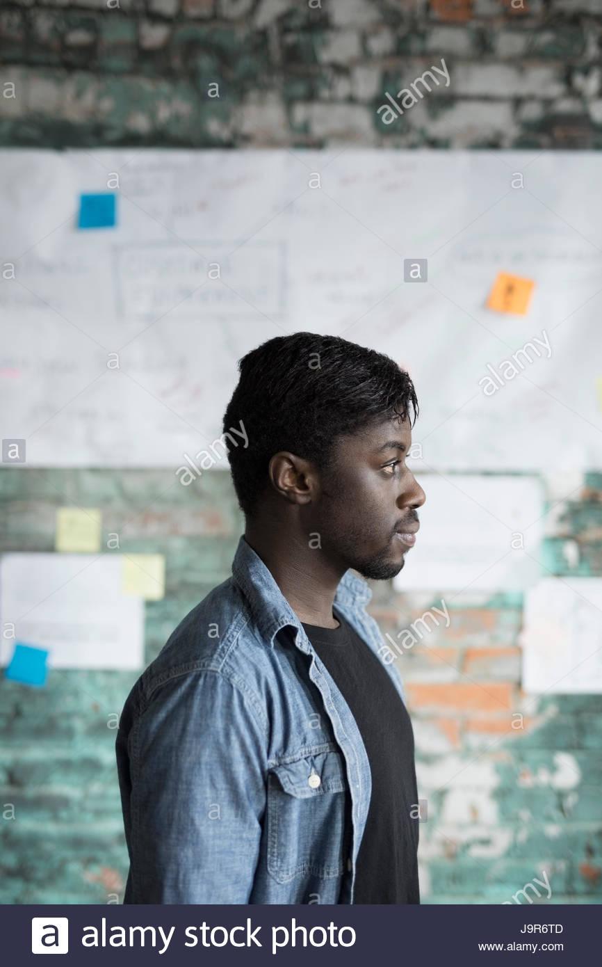 Profile pensive creative businessman brainstorming in office - Stock Image