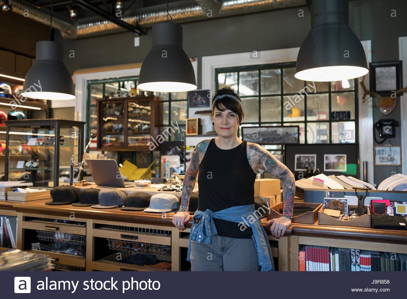 Portrait confident female motorcycle shop owner - Stock Image