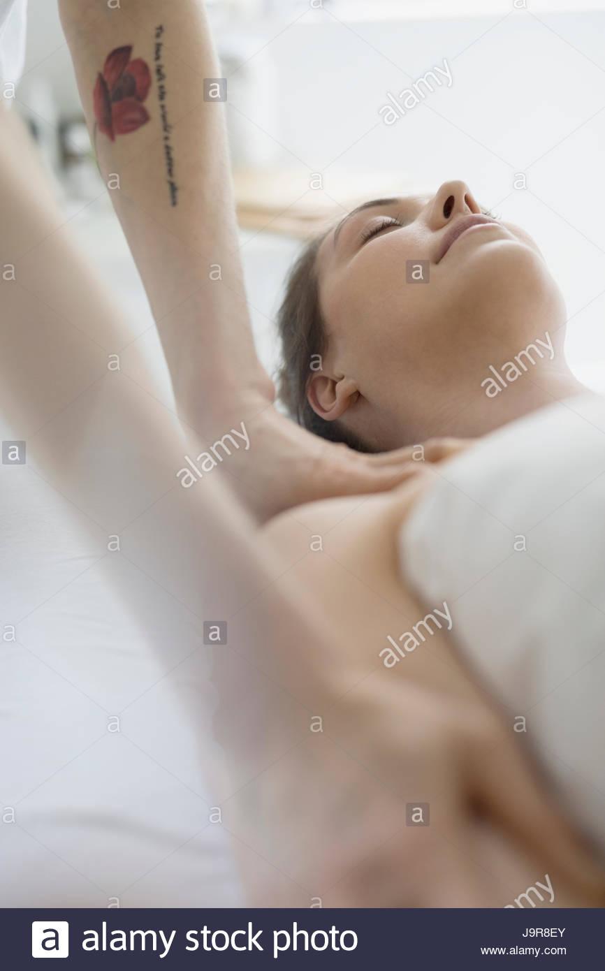 Serene woman receiving massage - Stock Image
