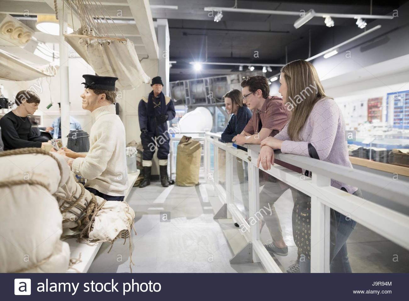 Family looking at Naval exhibit in war museum - Stock Image