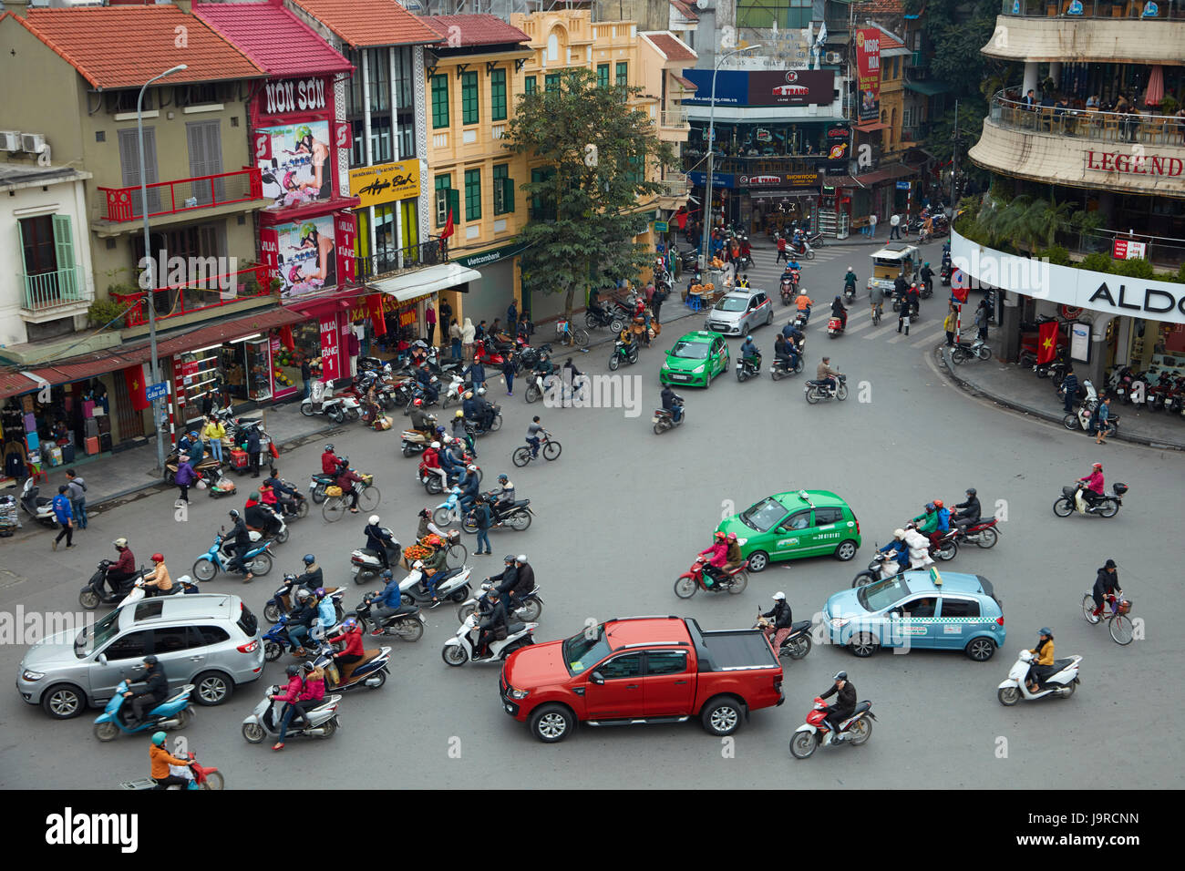 Crazy traffic at busy intersection by Hoan Kiem Lake and Old Quarter, Hanoi, Vietnam Stock Photo