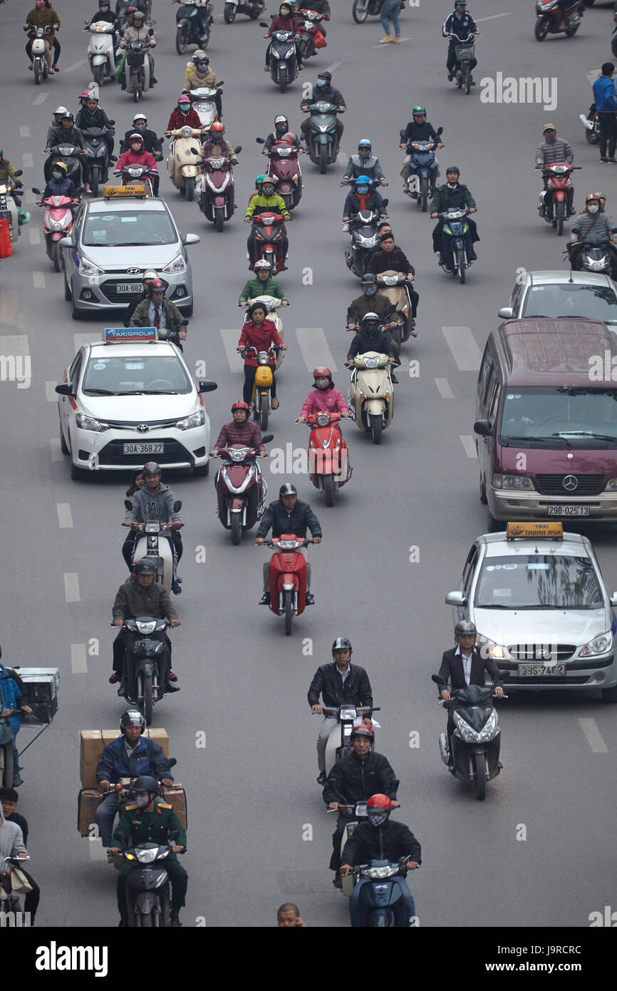 Busy street filled with motorcycles, Hanoi, Vietnam - Stock Image