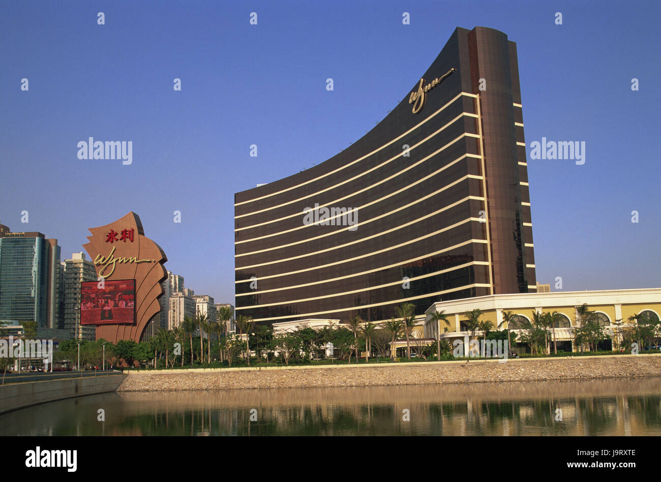 China,Macau,Wynn hotel and casino,Asia,Eastern Asia,peninsula,town,building,architecture,hotel building,modern,tourism,palms,water,water - Stock Image