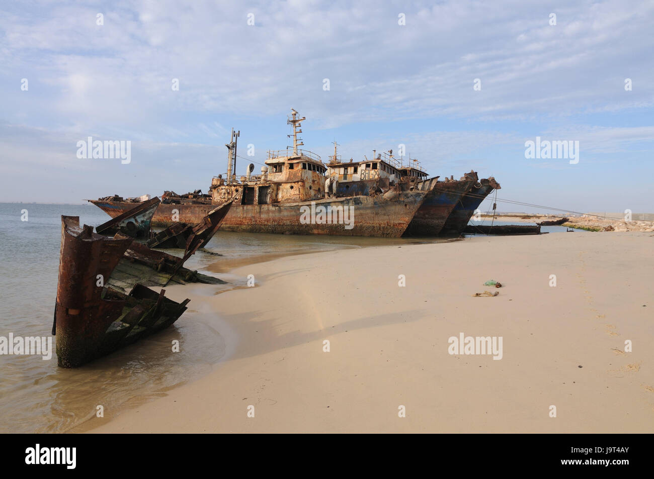 Mauritania,Nouadhibou,Cap Blanc,coast,ship wrecks,stranded,ships,ship cemetery,West Africa,Africa,old,the Atlantic,freighters,sea,navigation,hazy,water,rusts,water,wreck,environmental - Stock Image