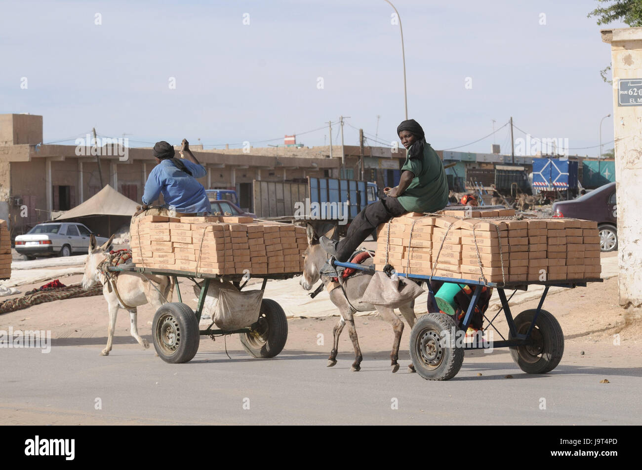 Mauritania,Nouakchott,men,donkey carts,costs transport,no model release,Africa,West Africa,town,capital,economy,building,houses,architecture,person,locals,turban,transport,carts,donkeys,animals,benefit Stock Photo