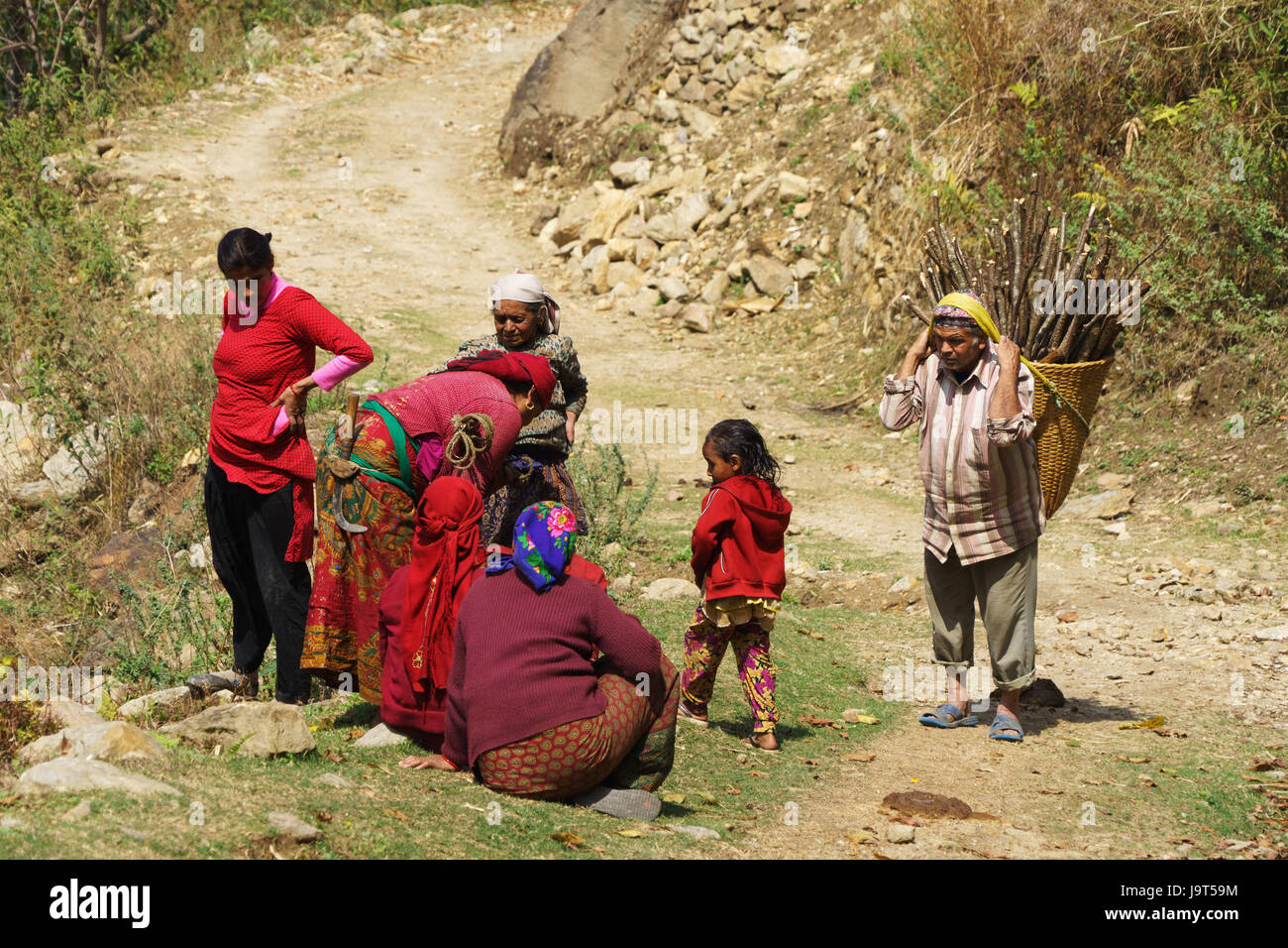 Local people on the Annapurna circuit betweeen Lili Bhir and Ghermu. - Stock Image