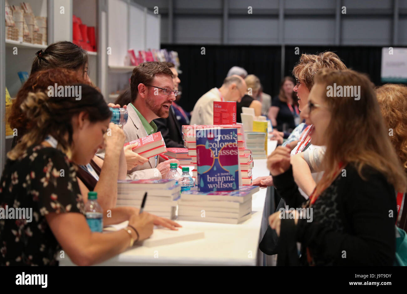 New York, USA. 2nd June, 2017. Book authors sign their books for visitors during the BookExpo 2017 in New York, - Stock Image