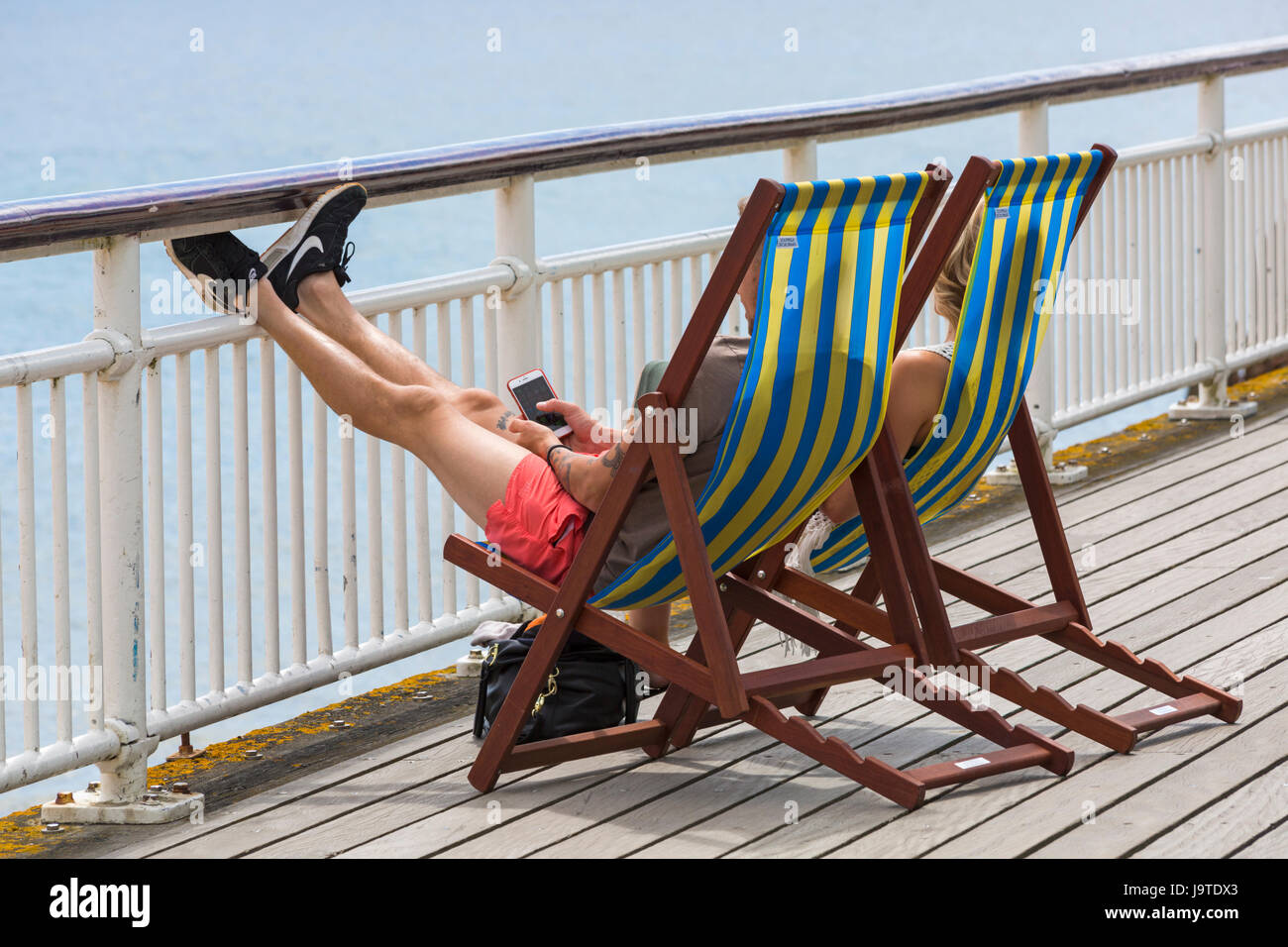 Bournemouth, Dorset, UK. 3rd June, 2017. UK weather: cooler and cloudier with sunny spells at Bournemouth - visitors - Stock Image