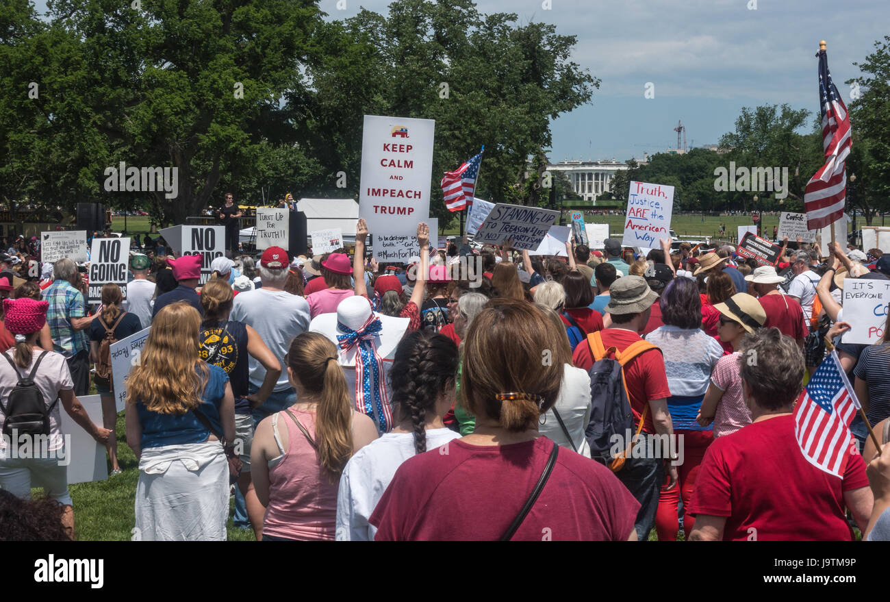 Washington, DC, USA. 3 June, 2017. Participants in the March for Truth rally near Washington Monument. listening Stock Photo