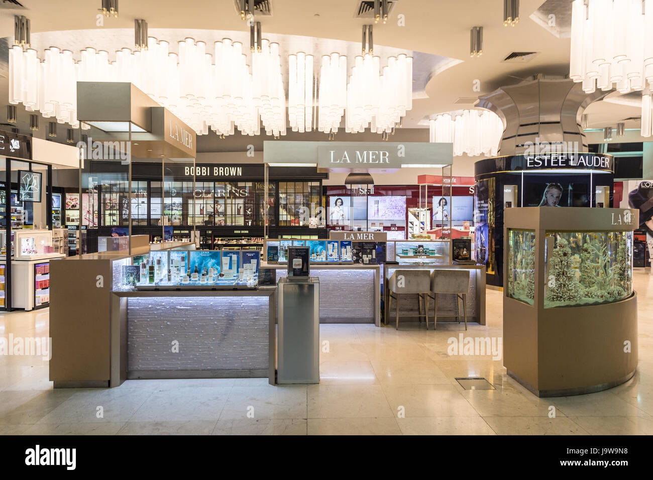 KUALA LUMPUR, MALAYSIA - MAY 19, 2017: Duty free beauty products such as make up and perfumes are displayed in a - Stock Image