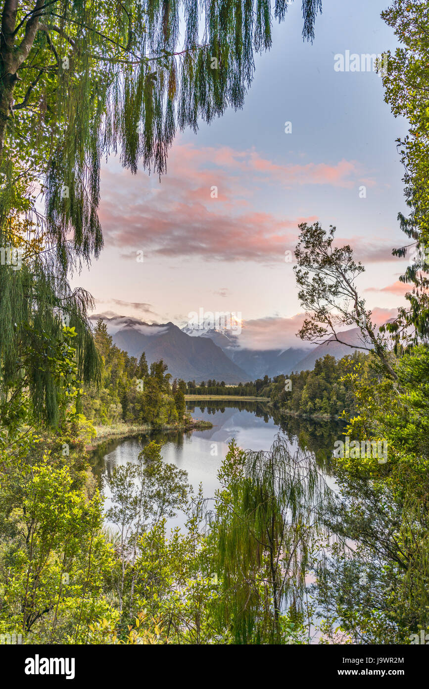 Sunset, View of the Views, Mt. Tasman and Mt. Cook, reflection in Lake Matheson, Mount Cook National Park - Stock Image