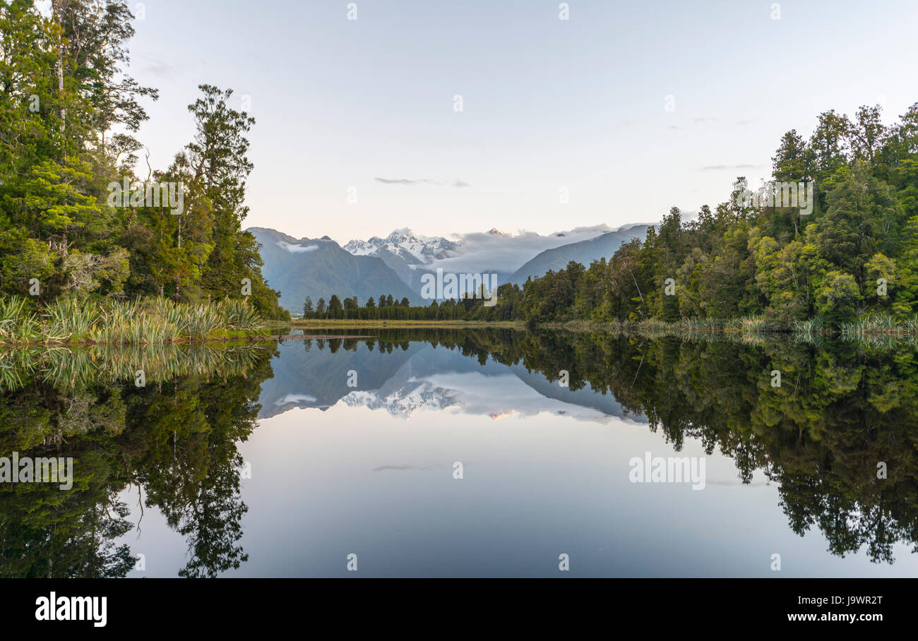 Mirror Island, Mt. Tasman and Mt. Cook, Reflection in Lake Matheson, Mount Cook National Park, Westland National - Stock Image