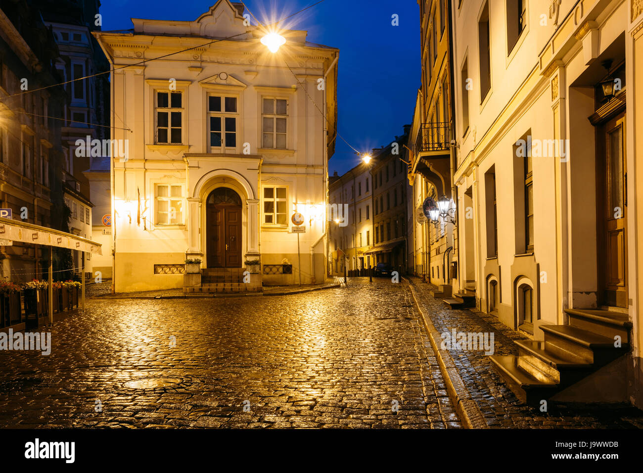 Riga, Latvia - July 3, 2016: Old Building At Intersection Of Maza Pils And Klostera Streets In Evening Or Night - Stock Image