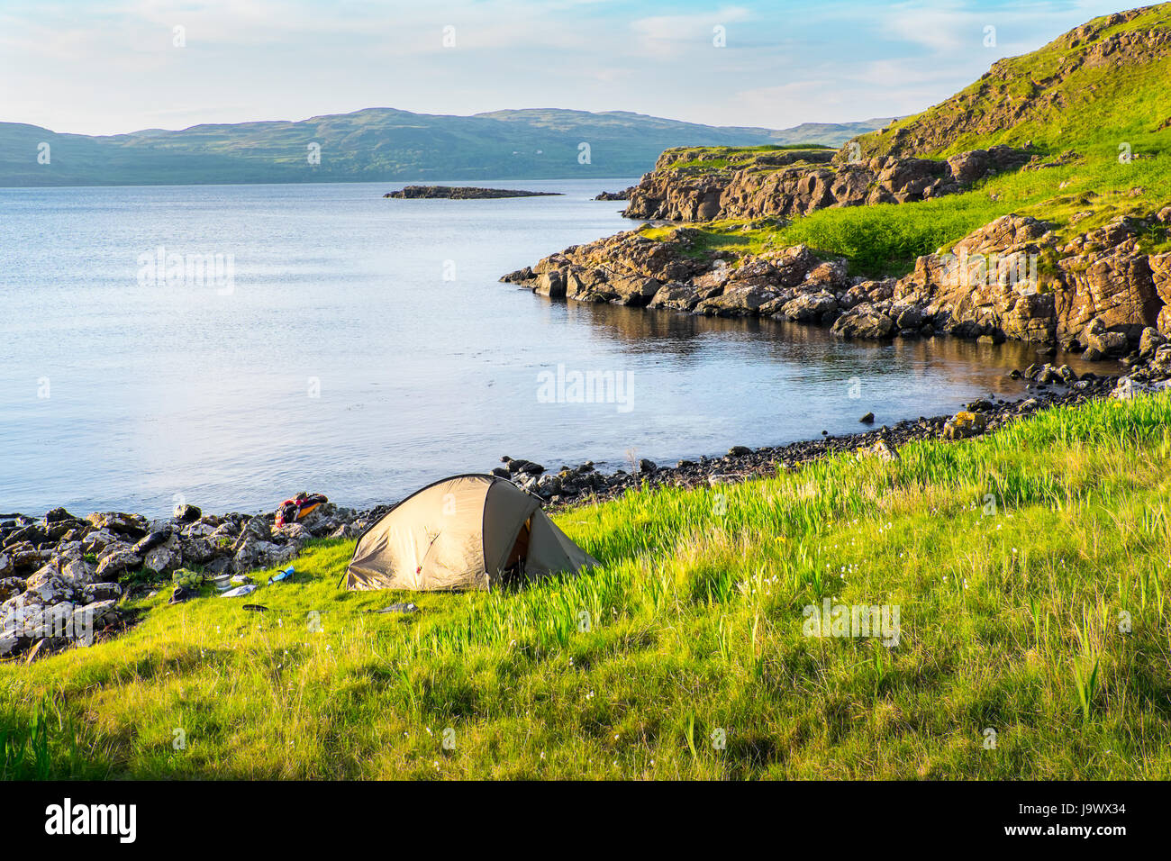 Wild camping whilst sea kayaking on the island of Ulva on the west coast of Mull in the Scottish Hebrides - Stock Image