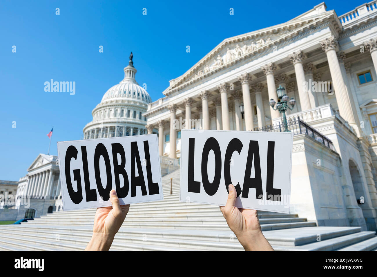 Protesters outside the US Capitol Building in Washington, DC holding protest signs supporting global and local issues, - Stock Image