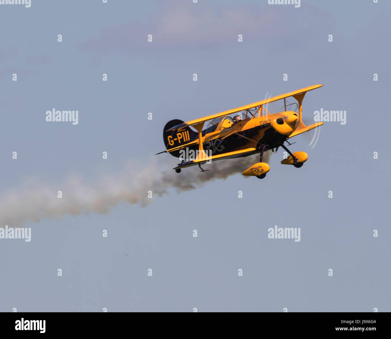 One of the two Pitts Special biplanes of the Trig Aerobatic Team at a Duxford AIr Show - Stock Image