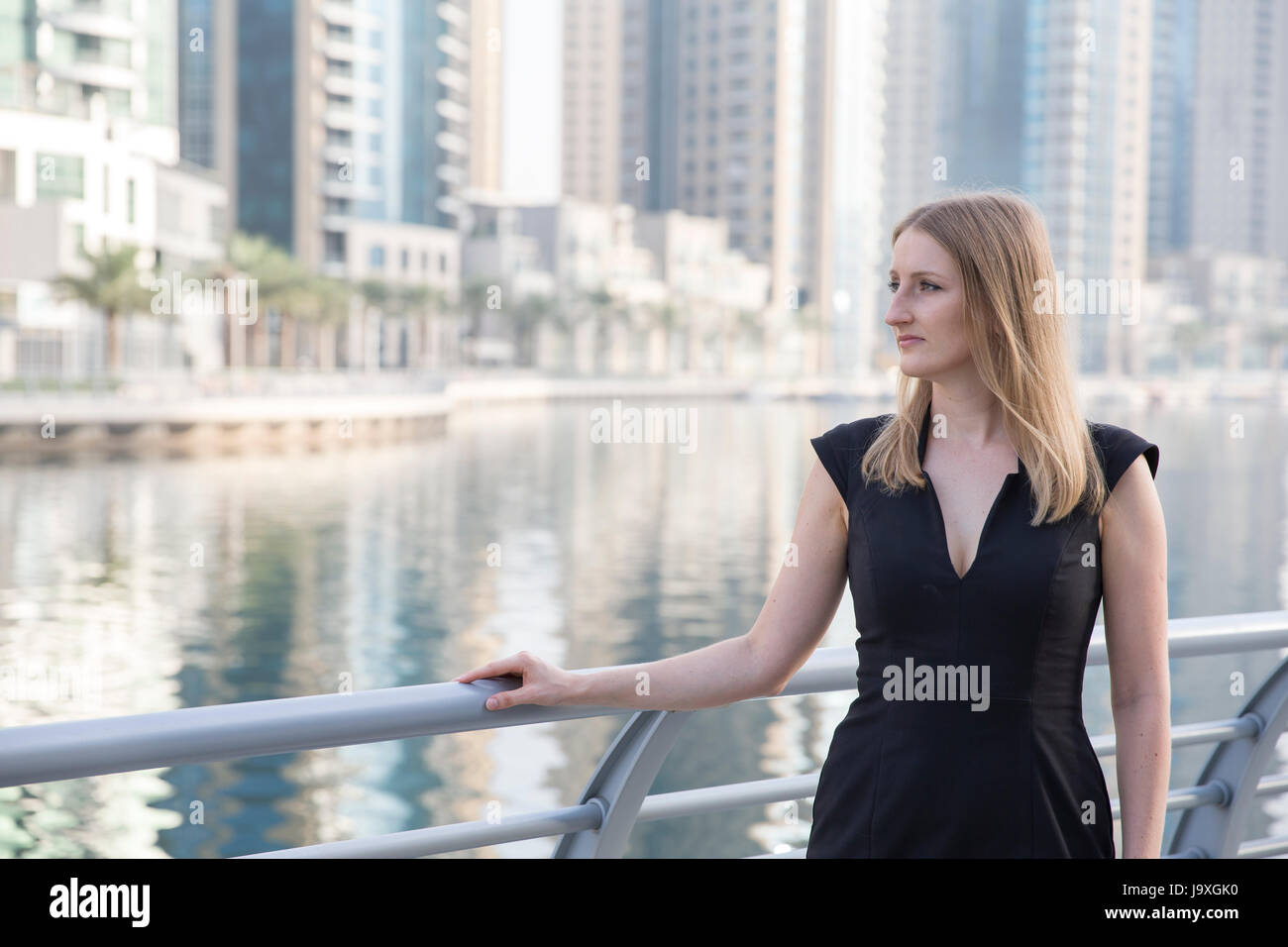 Businesswoman in a formalwear in Dubai Marina - Stock Image