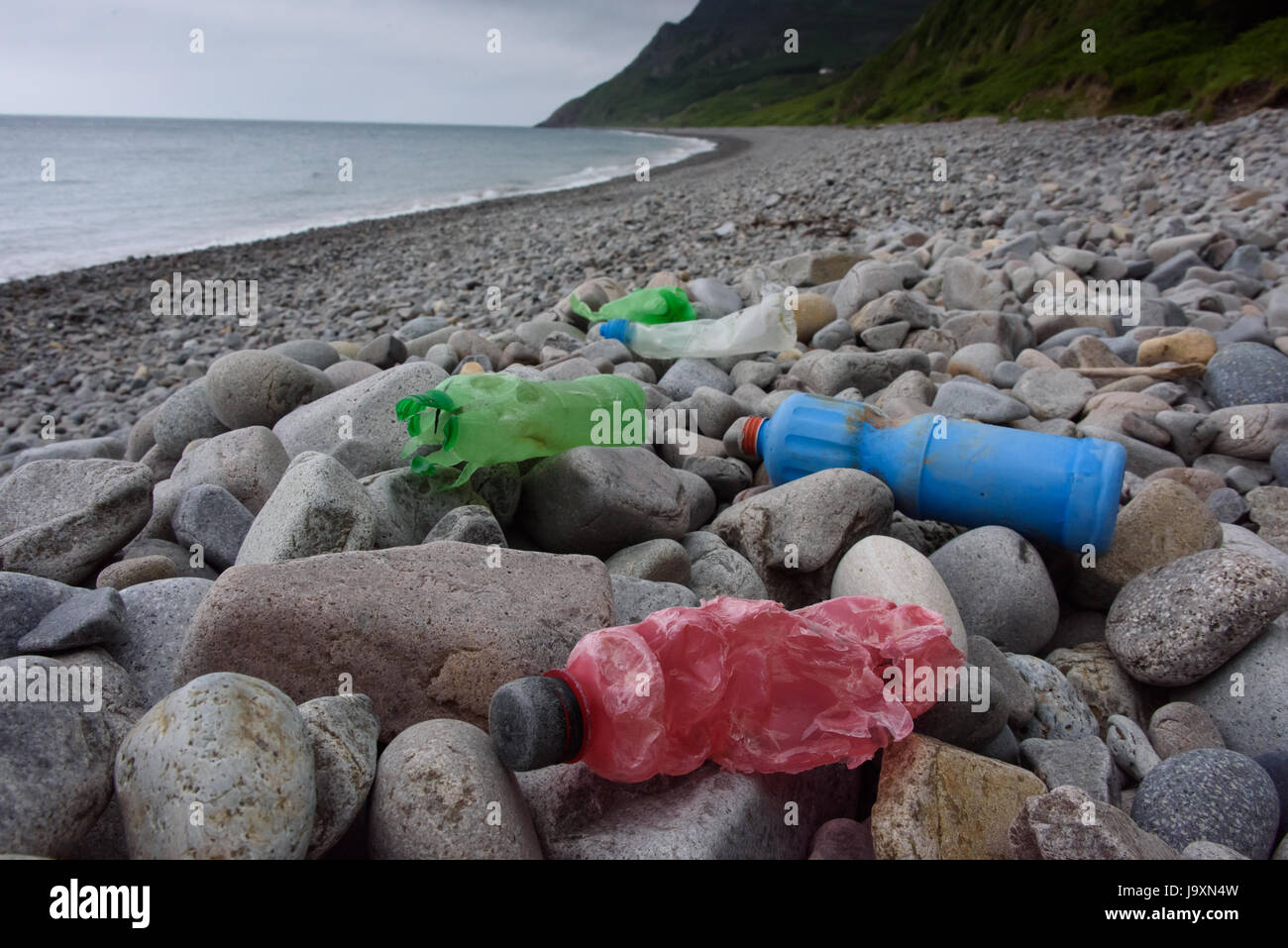 Plastic waste on beach in North Wales, UK - Stock Image