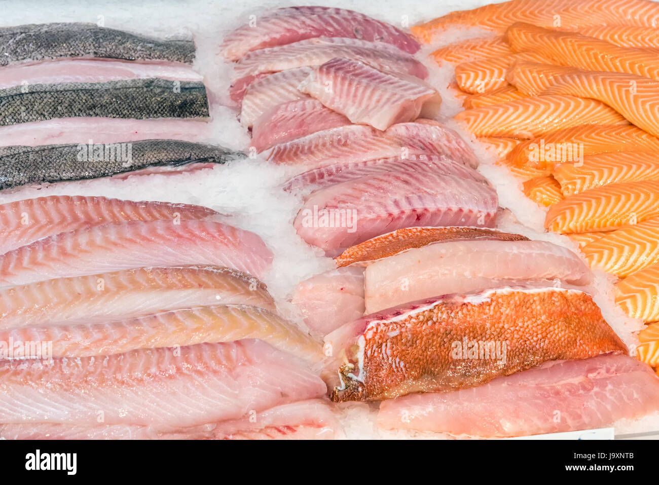Fish fillets for sale at a market - Stock Image