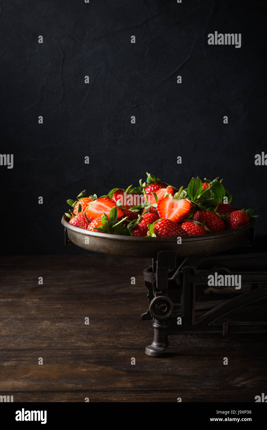 Fresh strawberries on vintage scales - Stock Image