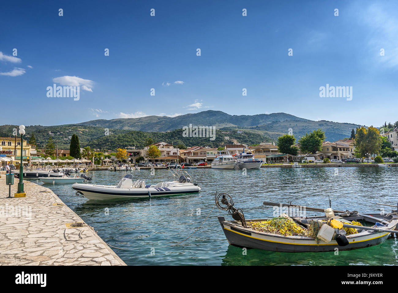 The small tourist village of Kassioppi in north east Corfu - Stock Image