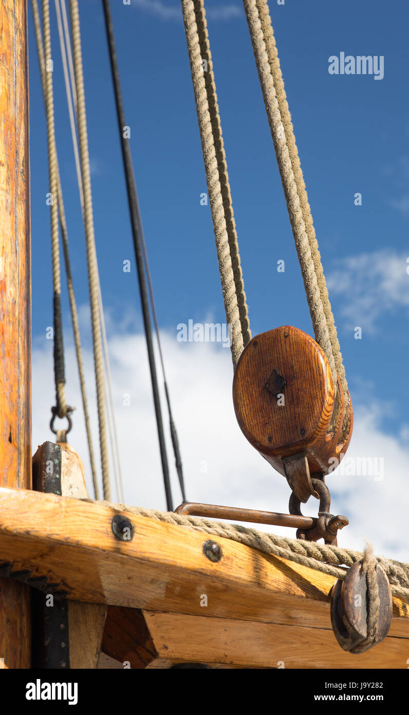 Pulley, block and tackle against blue sky on an old sailing ship off the west coast of Scotland - Stock Image