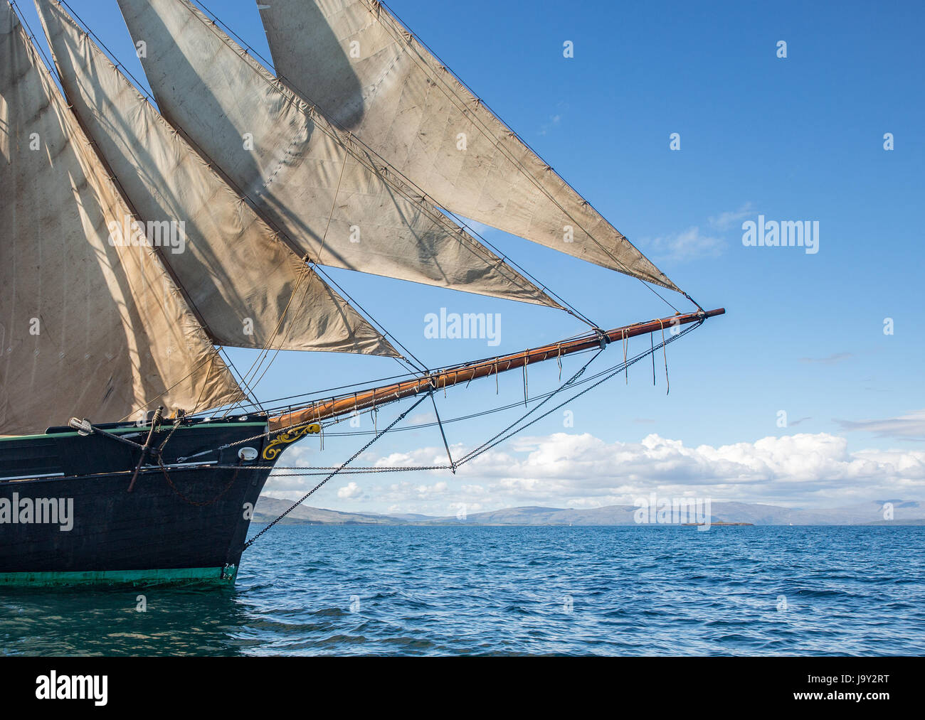 Twin masted sailing ship off the island of Kerrera, Oban, Scotland taken offshore from Gylan Castle Stock Photo