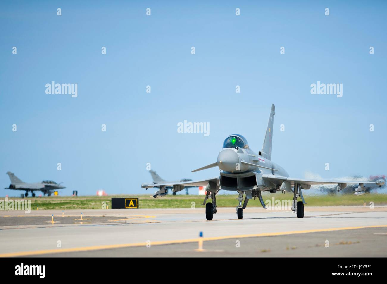 A British Royal Air Force Eurofighter Typhoon swing-role combat fighter aircraft lands on the runway at Joint Base Stock Photo
