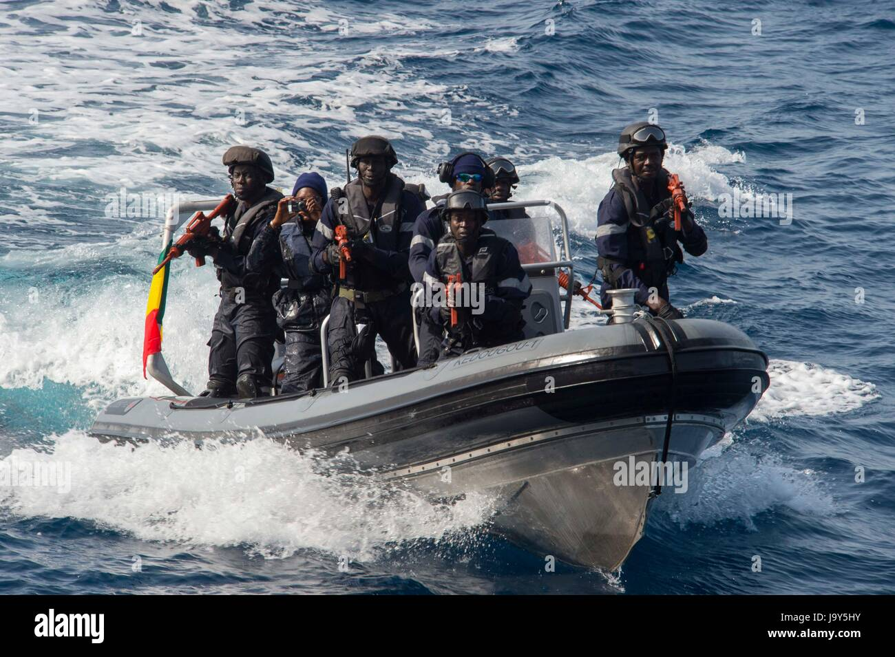 Senegalese soldiers approach the Portuguese Navy Karel Doorman-class frigate NRP Bartolomeu Dias for a visit, board, - Stock Image