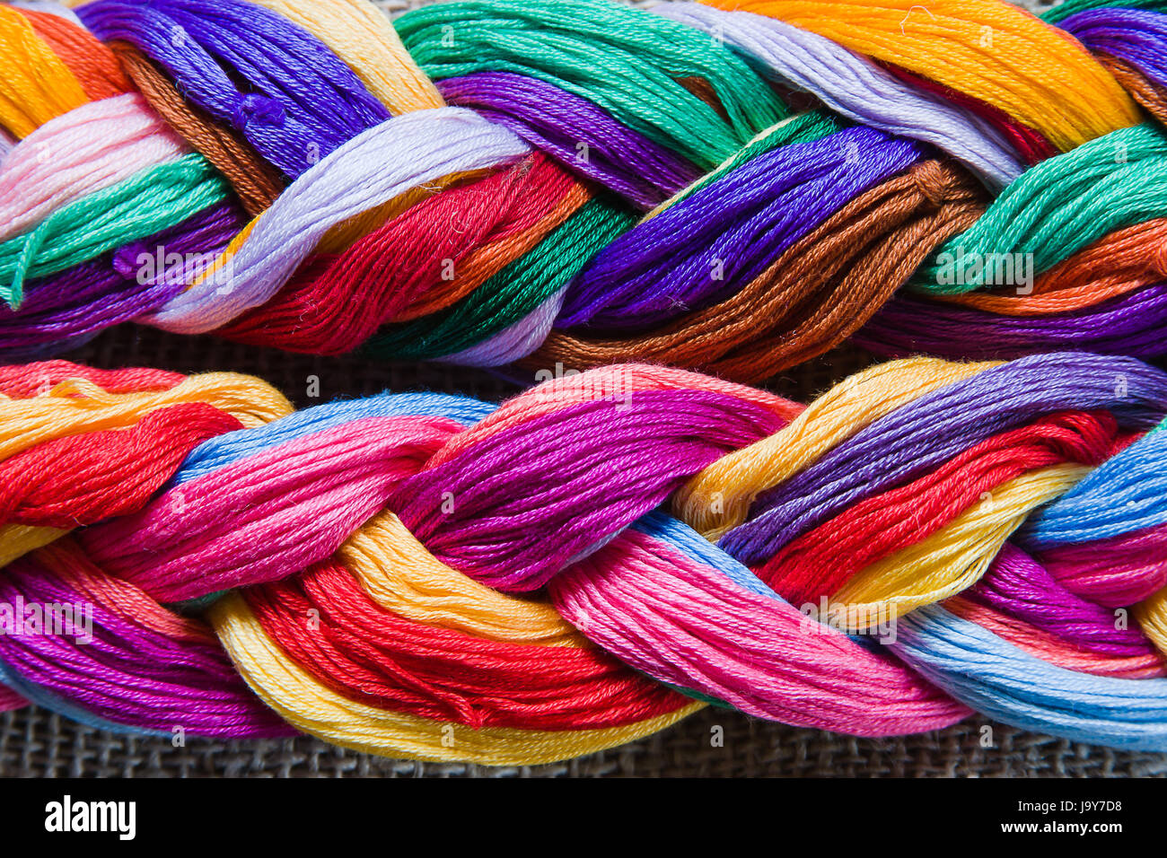 background from varicoloured threads - Stock Image